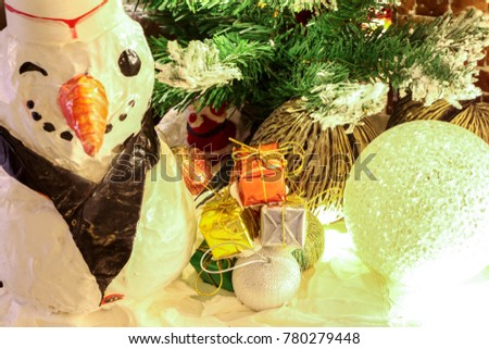 Christmas tree with gift and bell and Santa claus doll and lighting and snow decoration in house as happy new year day