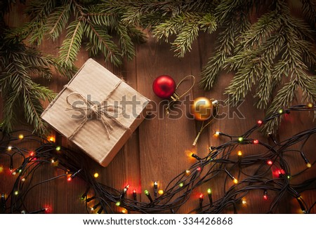 Christmas tree with gift box and decorations on wooden background space for lettering - stock photo