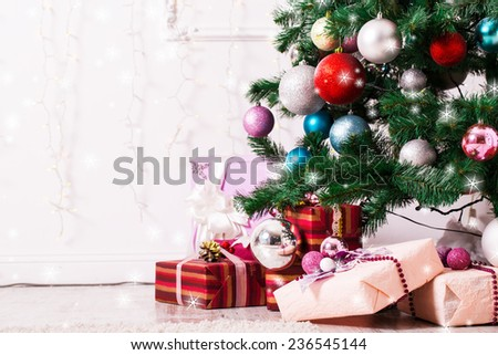 Christmas tree with gifts and stars - stock photo