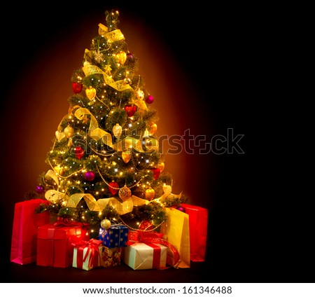Christmas Tree with Gifts isolated on black background. Beautiful Decorated Christmas Tree with Baubles and Garland - stock photo