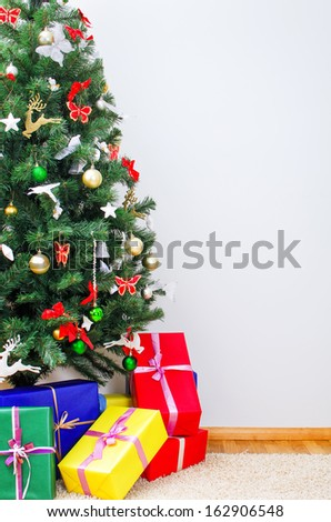 Christmas tree with gifts. Place for your text. - stock photo