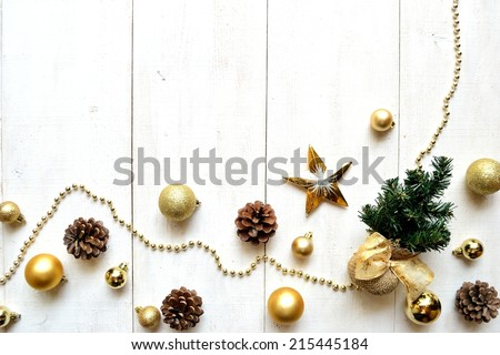 Christmas tree with gold ornaments on white wooden background - stock photo