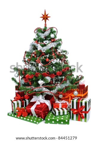 Christmas tree with heap of festive gift boxes decorated with satin ribbon isolated on white background