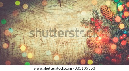 Christmas tree with lights on wood background - stock photo