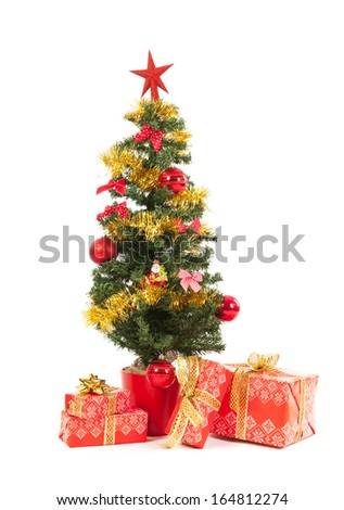 Christmas tree with luxury wrapped red gifts isolated over white background