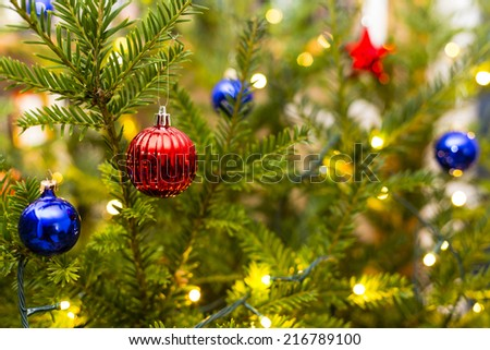 Christmas tree with ornaments - stock photo