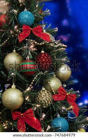 Christmas Tree With Ornaments And Blue Background Vertical Photo