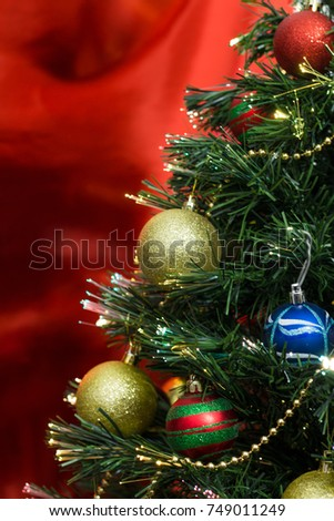 Christmas Tree With Ornaments And Red Background Vertical Photo