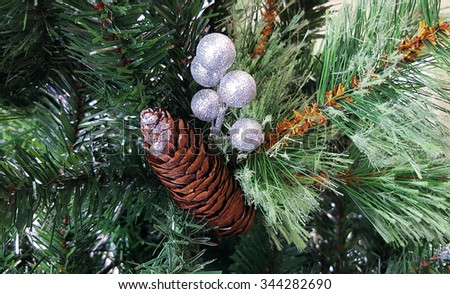 Christmas tree with pine cone  and silver balls background