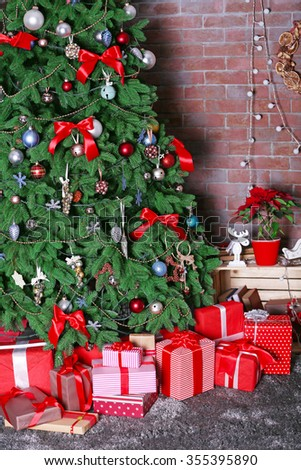 Christmas tree with presents in a room