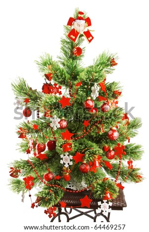 Christmas tree with red Christmas balls and decoration isolated on white background. - stock photo