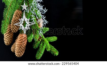christmas tree with shiny silver decoration over black background. festive ornaments. card concept with copy space - stock photo