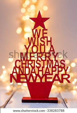 Christmas tree with wishful greetings - stock photo
