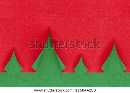 Christmas trees made from green and red paper. - stock photo