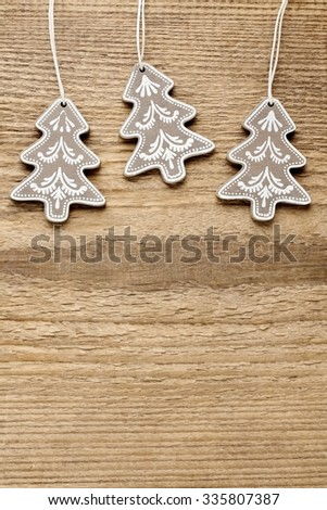Christmas trees on rough wooden background. Copy space
