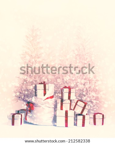 Christmas trees with heap of gift boxes  - stock photo