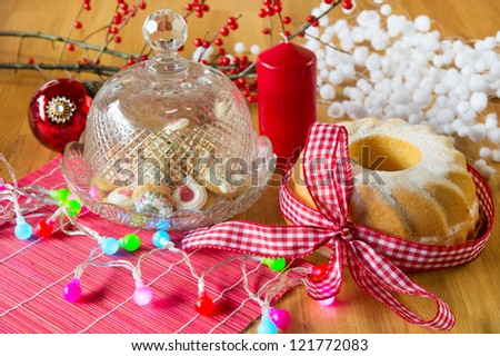 Christmas turban and cupcakes as delicatessen with colorful lights