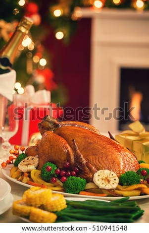 Christmas turkey dinner in front of Christmas tree near fireplace