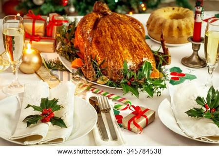 Christmas turkey dinner table  - stock photo