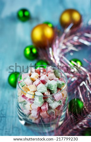 Christmas turkish delight decorated with balls and tinsel - stock photo