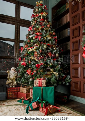 Christmas under a fir-tree - stock photo