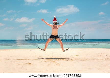 Christmas vacation - man in santa hat on the Maldives tropical beach