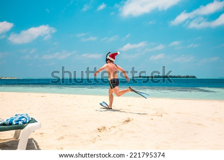 Christmas vacation - man in santa hat on the Maldives tropical beach - stock photo