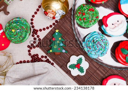 Christmas various gingerbread Christmas decoration with food, cakes, cupcakes, confection. Christmas tree with ornaments. - stock photo