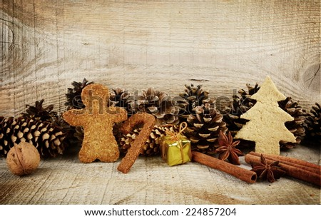 Christmas various gingerbread cookies with gift scene on wooden surface - stock photo