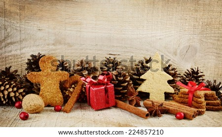 Christmas various gingerbread cookies with red gift, christmas tree, santa claus, stick scene on wooden surface - stock photo