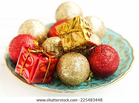 Christmas Vintage Decorations with Glittered Globes and Little Gifts - stock photo