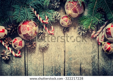Christmas Vintage Fir Tree Toys, Red Balls, Coniferous, Candy Cane, Pine Cones as Decor on Wooden Planks. Toned - stock photo