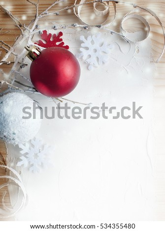 Christmas vintage frame. Red and white christmas balls on a wooden background.