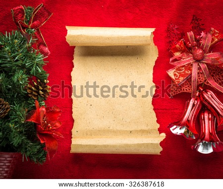Christmas vintage scroll on red background. - stock photo