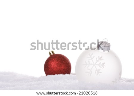 christmas white background, with snow and christmas balls (selective focus) - stock photo