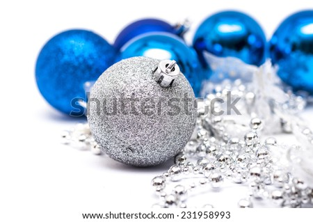 Christmas white  ball in  focus and blue balls in background with ribbons