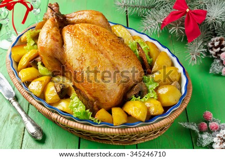 Christmas whole roasted chicken stuffed with mushrooms and baked with potatoes and mushrooms  - stock photo