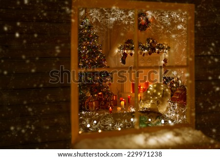 Christmas Window Holiday Home Lights, Room Decorated By Xmas Tree Candles Presents Gift, New Year Night, Snow And Frost - stock photo