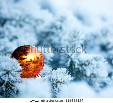 Christmas winter background. Christmas ball on tree - stock photo
