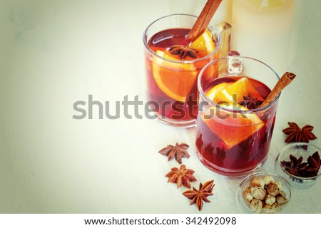 Christmas Winter Drink. Two Glasses with Mulled Wine. Selective Focus, Shallow DOF. Image Toned with Instagram Colors.  - stock photo