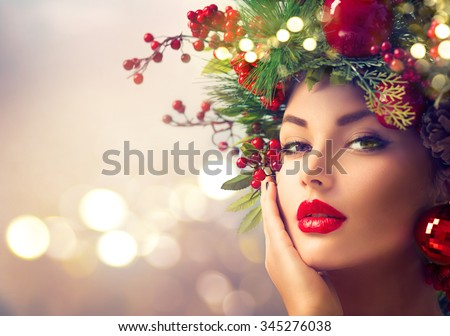 Christmas Winter Fashion Woman. Beautiful New Year and Christmas Tree Holiday Hairstyle, Make up. Beauty Model Girl over glowing Background. Creative Hair style decorated with Baubles  - stock photo
