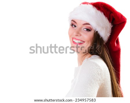 Christmas winter happiness concept. Woman wearing santa helper hat portrait isolated on white