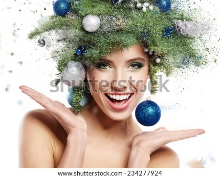 Christmas Winter Woman. Beautiful New Year and Christmas Tree Holiday Hairstyle and Make up. - stock photo