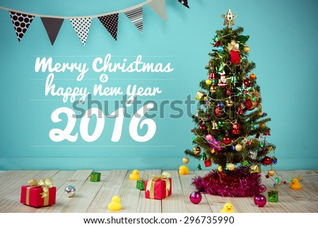 Christmas with decorated item hanging in a tree - stock photo