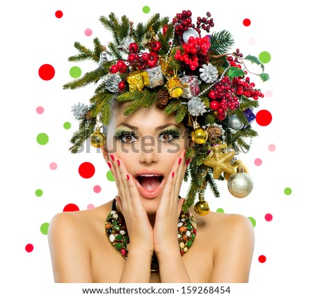 Christmas Woman. Beautiful New Year and Christmas Tree Holiday Hairstyle and Make up. Beauty Girl Portrait. Colorful Makeup, Hair, Nail polish and Accessories. Surprised Woman. Open Mouth, Emotions  - stock photo