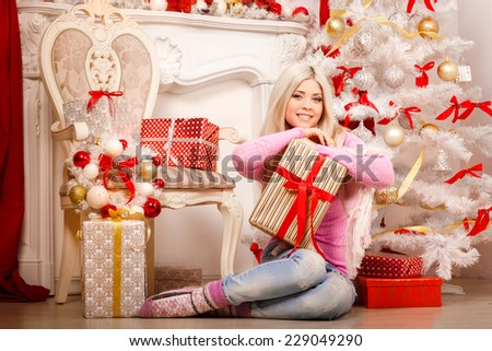 Christmas woman happy new year interior, winter concept smiling girl Santa with gift boxes. Xmas girl Christmas background series. Female at new year tree home Christmas party. merry christmas. series - stock photo