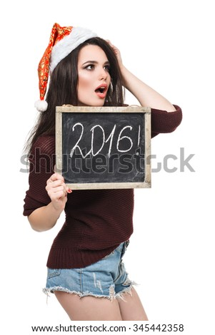 Christmas woman hold card with the word of 2016. Santa hat. Isolated girl.  - stock photo