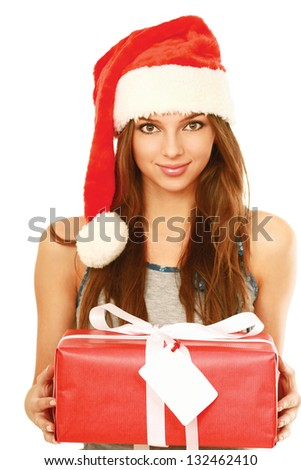 Christmas woman holding gift wearing Santa hat. Isolated on white background.