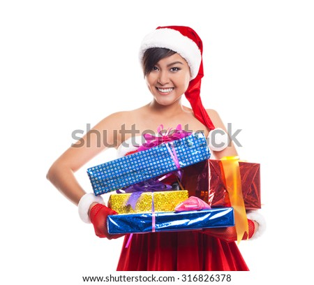 Christmas woman holding gifts wearing Santa hat.Iisolated on white background. Smiling woman portrait of a beautiful Asian model. - stock photo