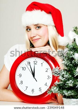 Christmas Woman. New Year and Christmas Tree Santa claus hat. clock. Winter season. - stock photo